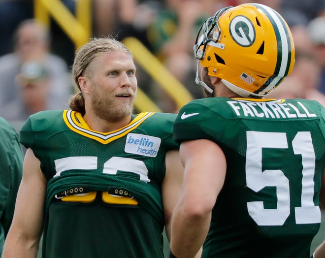 Green Bay Packers linebacker Clay Matthews (52) talks to linebacker Kyler Fackrell (51) during training camp practice at Ray Nitschke Field on Friday, August 3, 2018 in Ashwaubenon, Wis. 