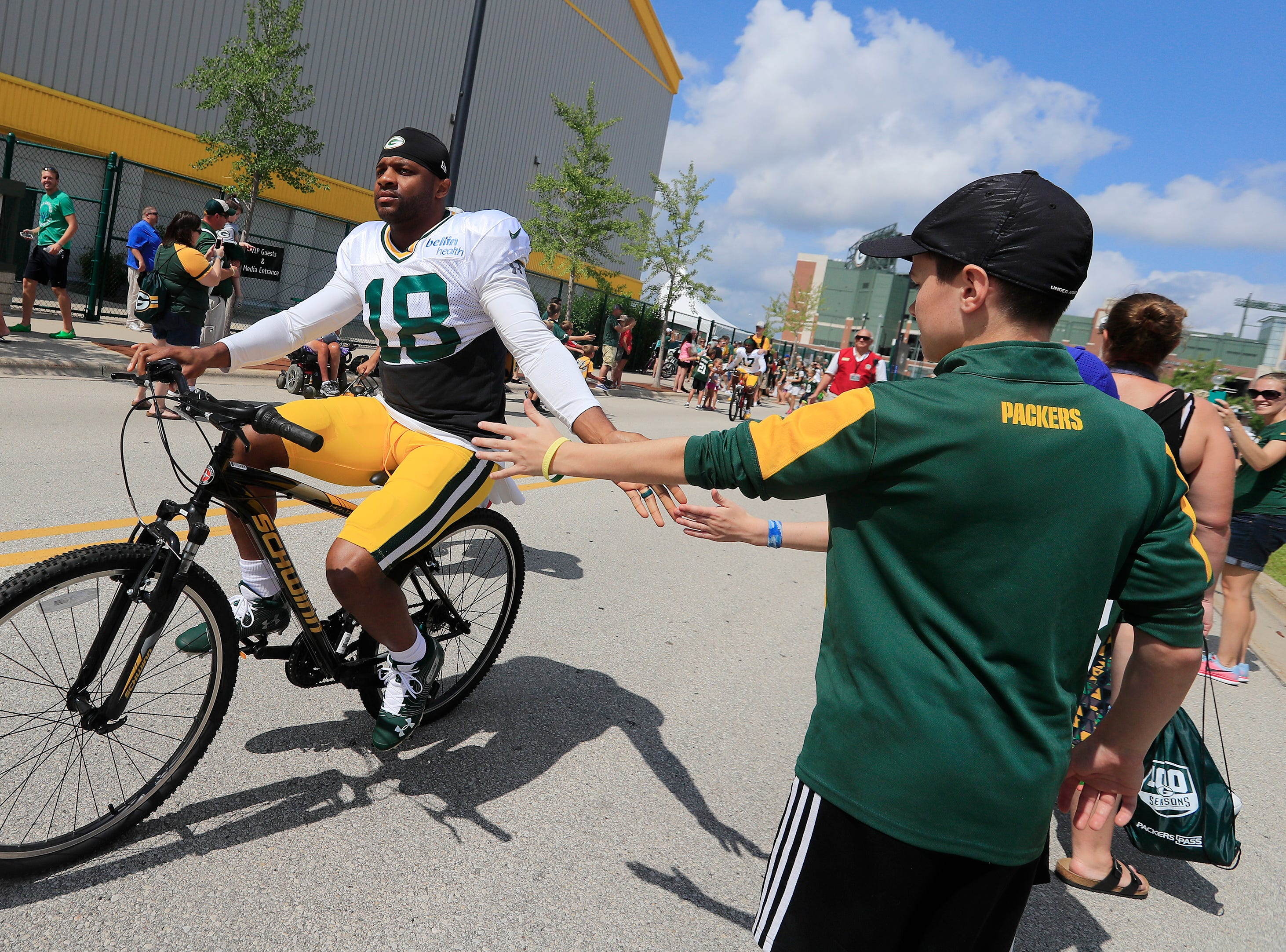 Green Bay Packers wide receiver Randall Cobb (18) rides a bike to during training camp practice at Ray Nitschke Field on Friday, August 3, 2018 in Ashwaubenon, Wis. 