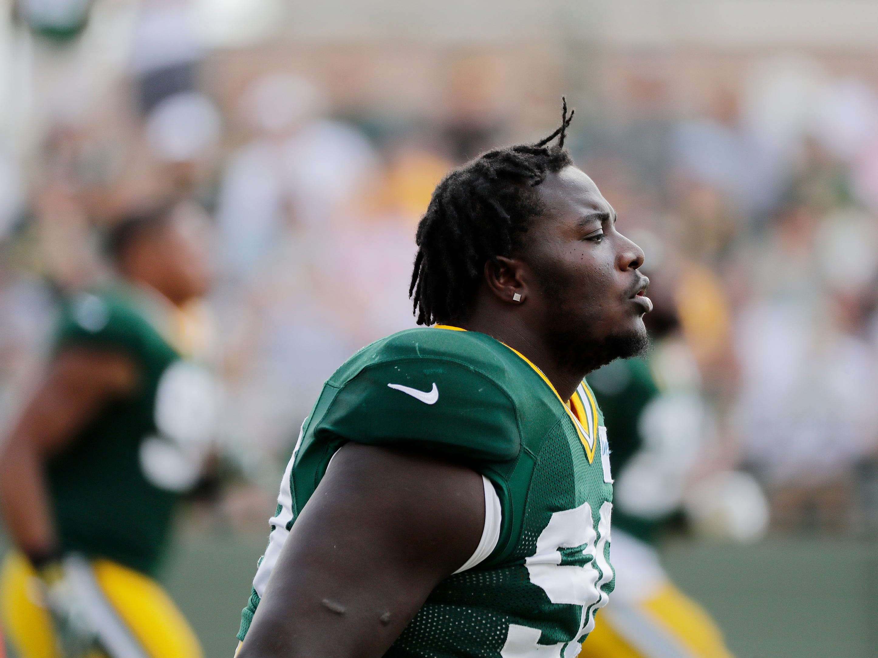 Green Bay Packers defensive tackle Montravius Adams (90) warms up during training camp practice at Ray Nitschke Field on Friday, August 3, 2018 in Ashwaubenon, Wis. 