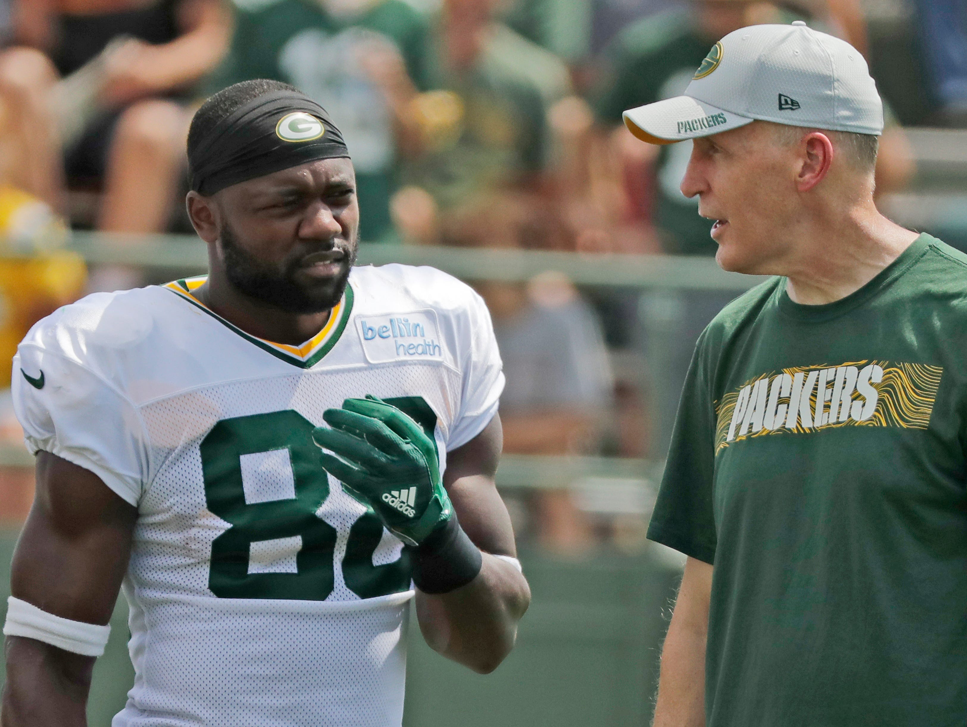 Green Bay Packers running back Ty Montgomery (88) talks to offensive coordinator Joe Philbin during training camp practice at Ray Nitschke Field on Friday, August 3, 2018 in Ashwaubenon, Wis. 