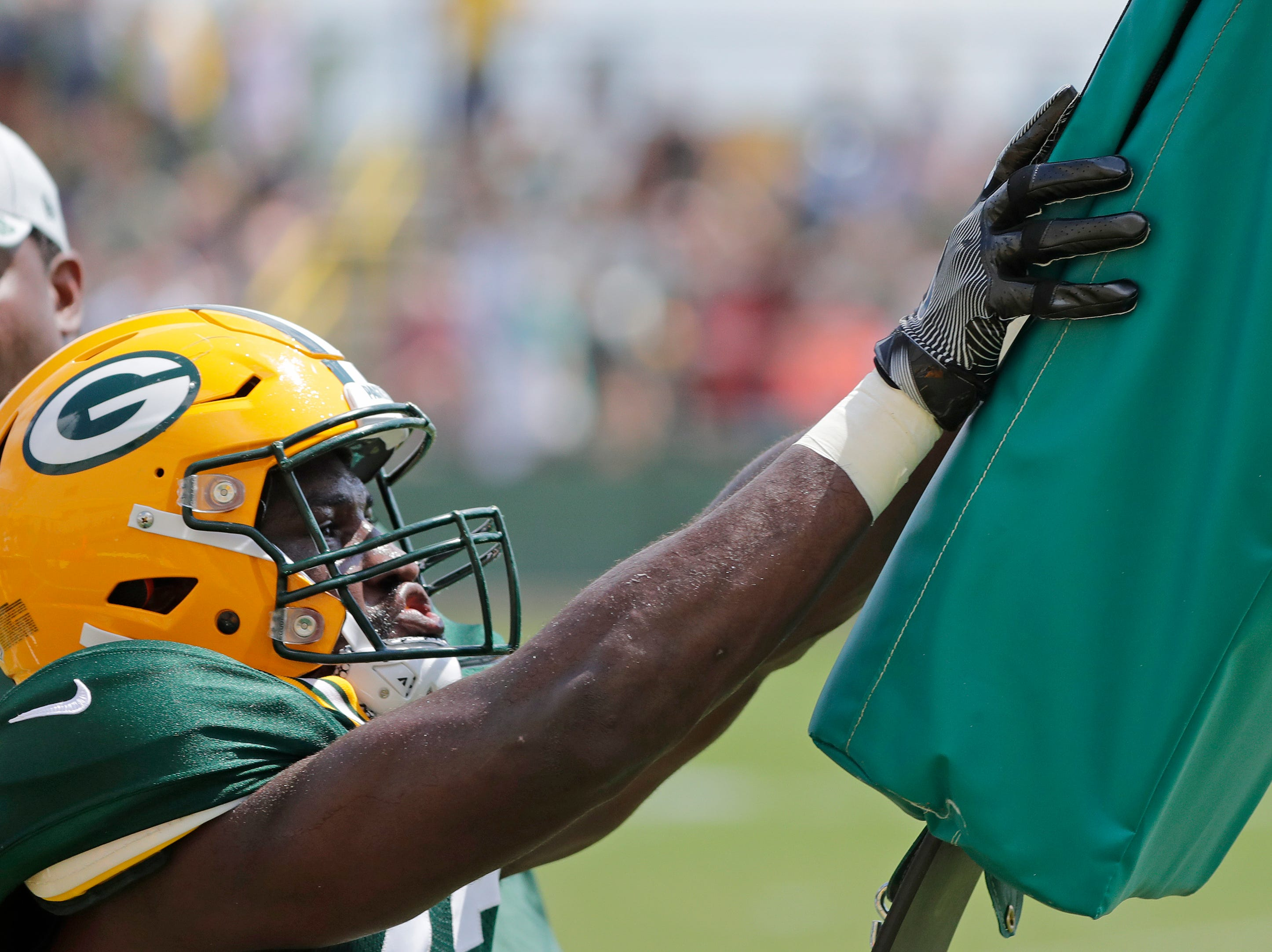 Green Bay Packers linebacker Oren Burks (42) runs through a hitting drill during training camp practice at Ray Nitschke Field on Friday, August 3, 2018 in Ashwaubenon, Wis. 