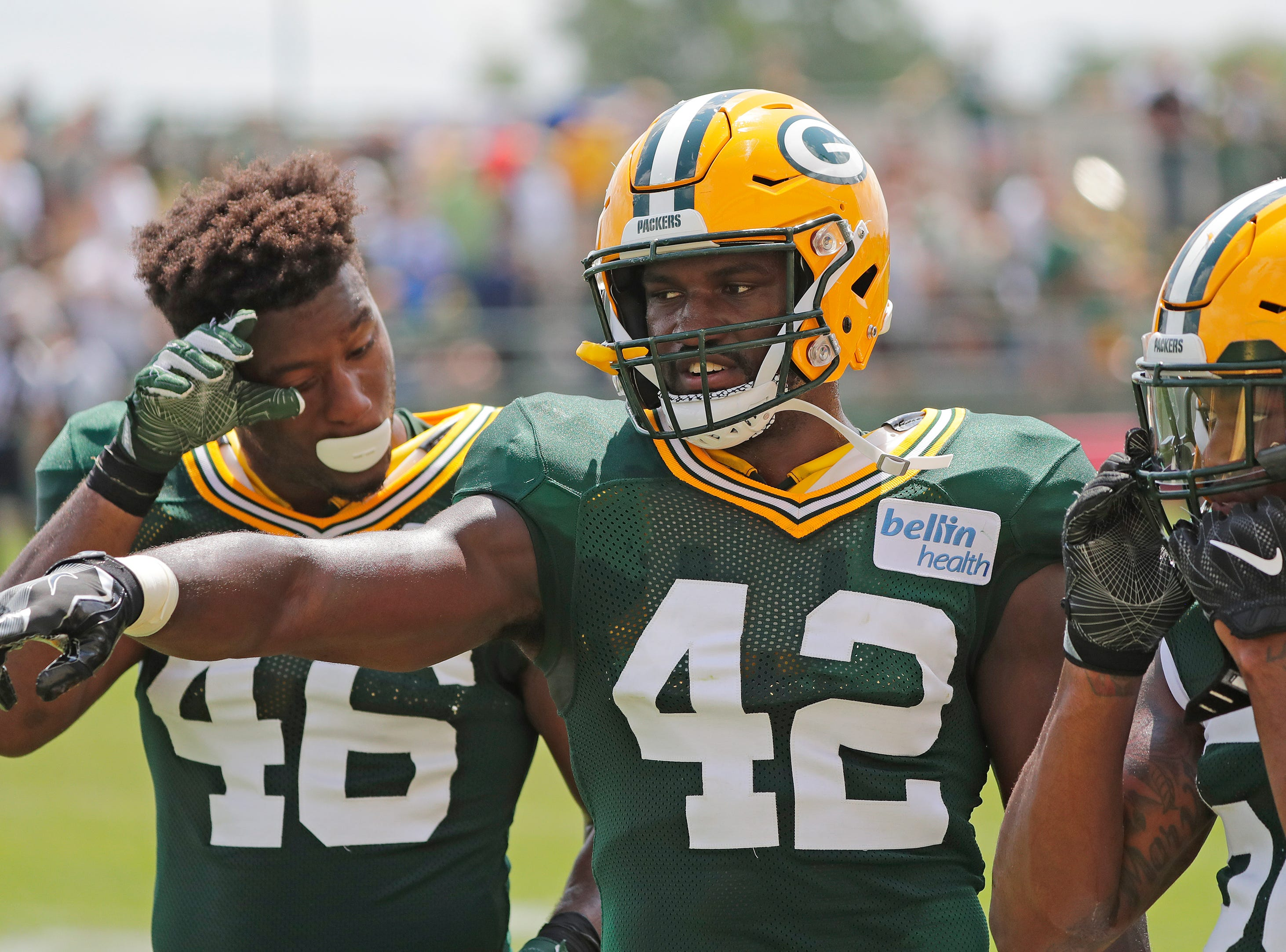 Green Bay Packers linebacker Oren Burks (42) talks to teammates during a drill at training camp practice at Ray Nitschke Field on Friday, August 3, 2018 in Ashwaubenon, Wis. 