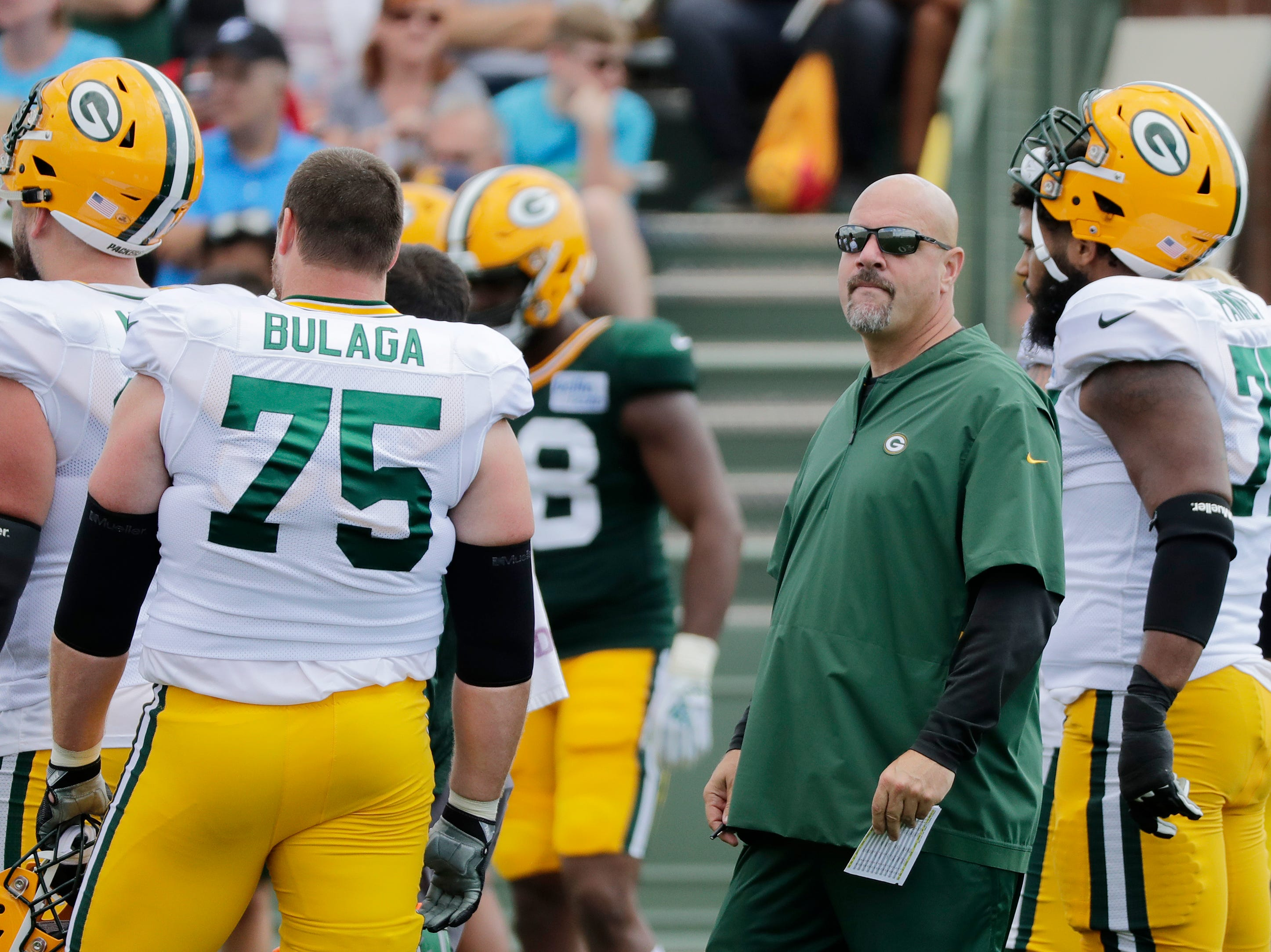 Green Bay Packers defensive coordinator Mike Pettine looks on during training camp practice at Ray Nitschke Field on Friday, August 3, 2018 in Ashwaubenon, Wis. 