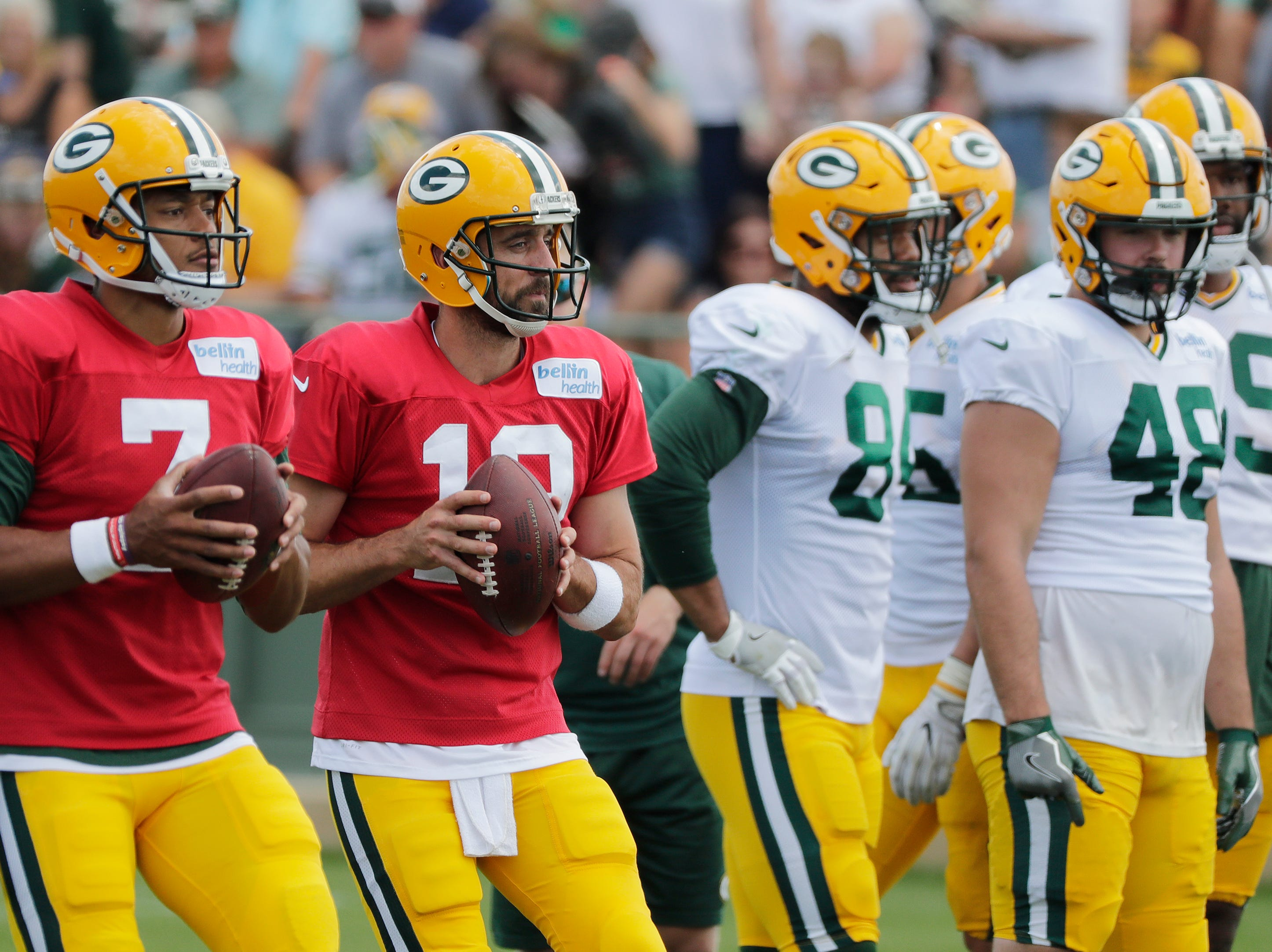 Green Bay Packers quarterbacks Brett Hundley (7) and Aaron Rodgers (12) drop back to pass during training camp practice at Ray Nitschke Field on Friday, August 3, 2018 in Ashwaubenon, Wis. 