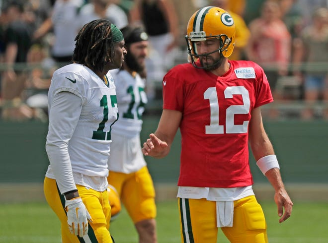 Green Bay Packers quarterback Aaron Rodgers (12) talks to wide receiver Davante Adams (17) during training camp practice at Ray Nitschke Field on Friday, August 3, 2018 in Ashwaubenon, Wis. 