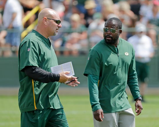 Green Bay Packers defensive coordinator Mike Pettine talks to defense pass game coordinator Joe Whitt Jr during training camp practice at Ray Nitschke Field on Friday, August 3, 2018 in Ashwaubenon, Wis. 