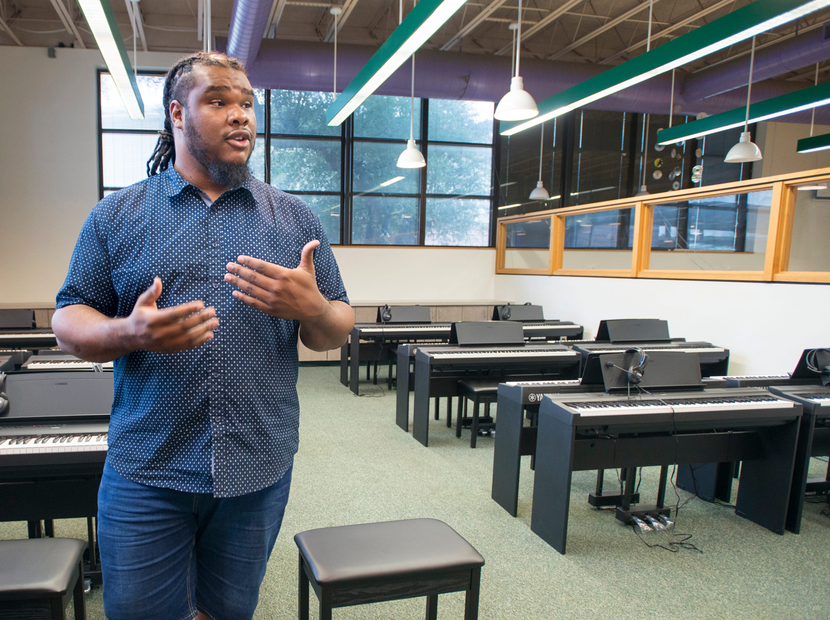 Music teacher Caleb Lovely sings the praises of the new piano studio at Warrington Middle School in Pensacola on Friday, August 2, 2018.