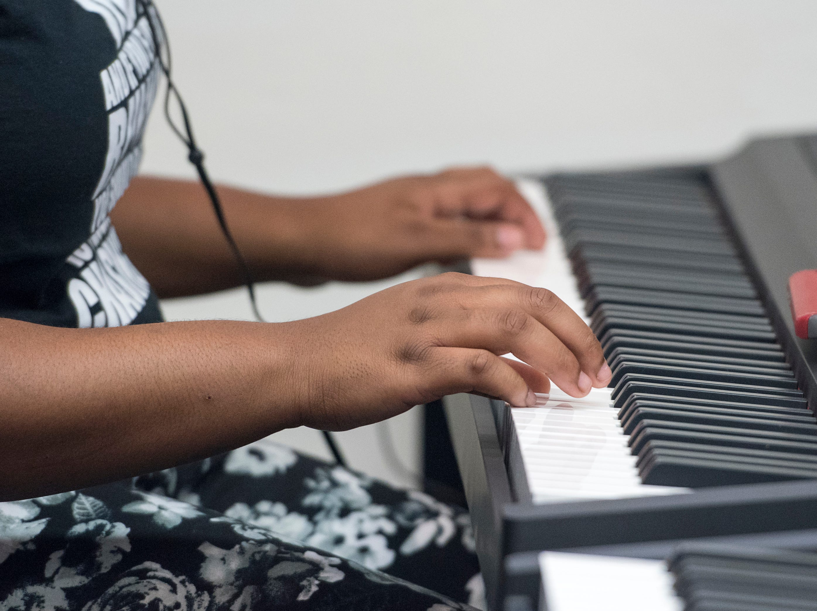 Chasity Patterson, 14, tries out the new piano studio at Warrington Middle School in Pensacola on Friday, August 2, 2018.