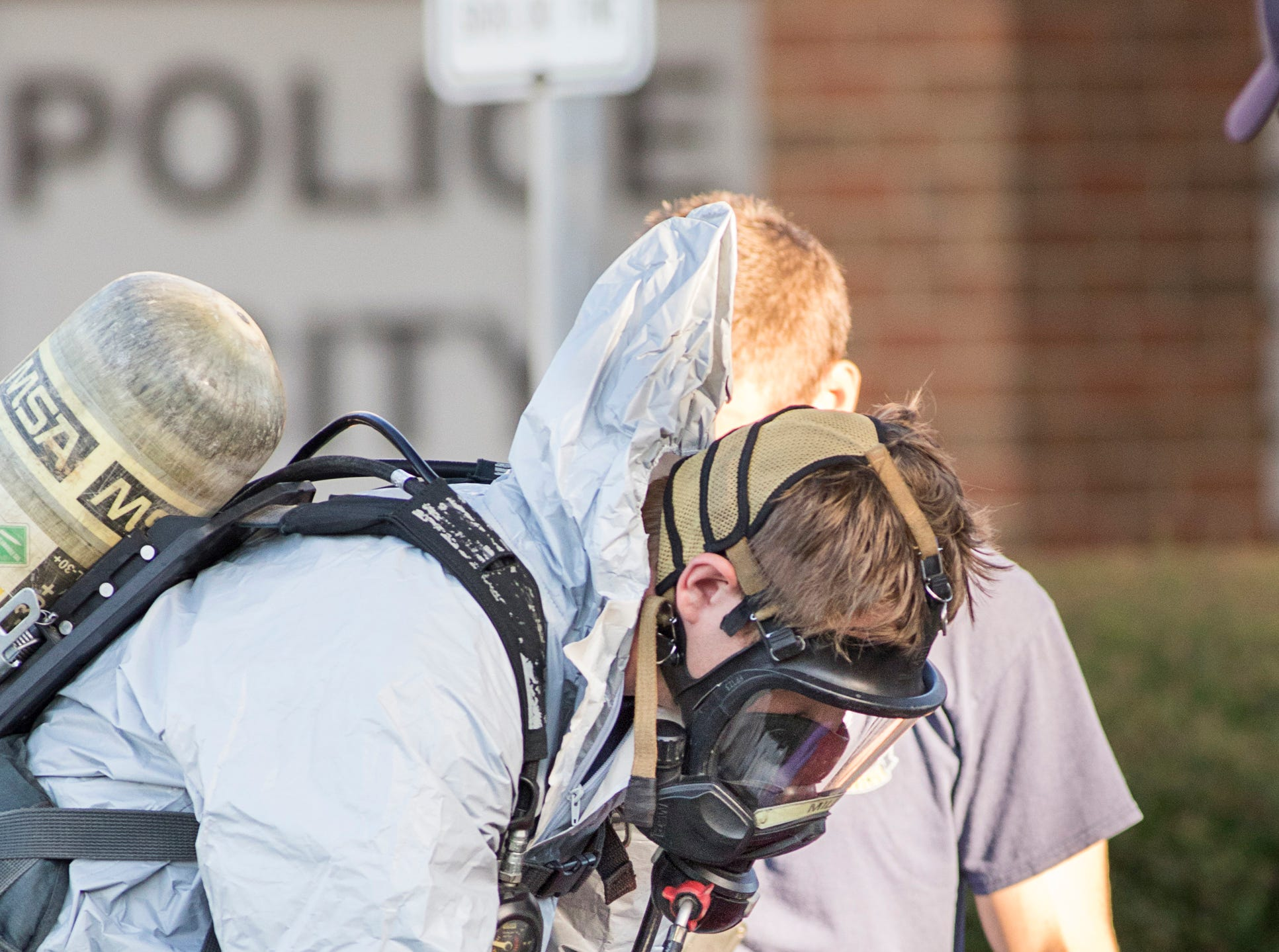 The Escambia County Hazmat team removes questionable material after five police officers were sent to the hospital from the Pensacola Police Department Headquarters in Pensacola on Friday, August 3, 2018.