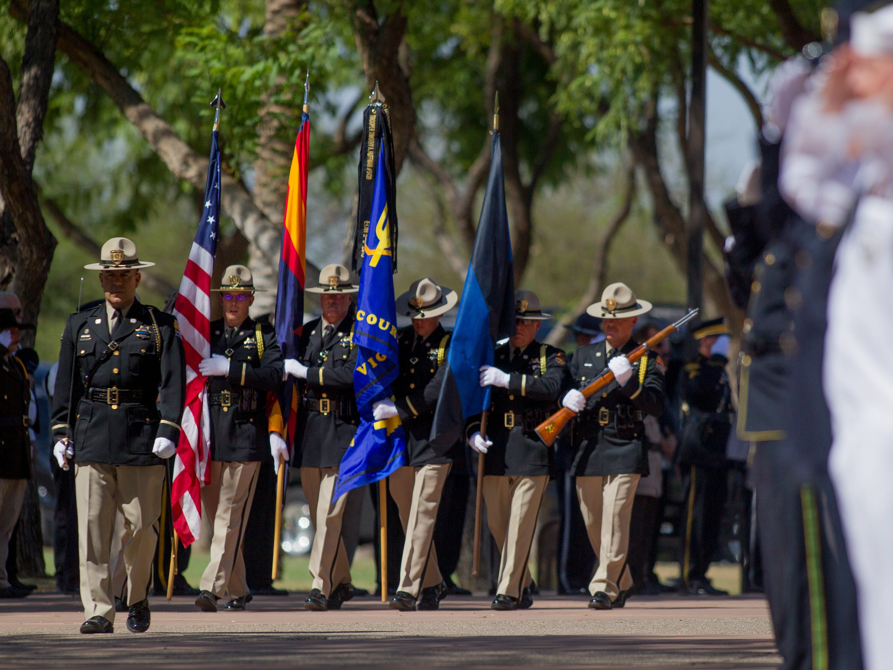 The honor guard marches in on Aug, 3, 2018, during a funeral for fallen DPS  Trooper Tyler Edenhofer at Christ's Church of the Valley in Peoria.