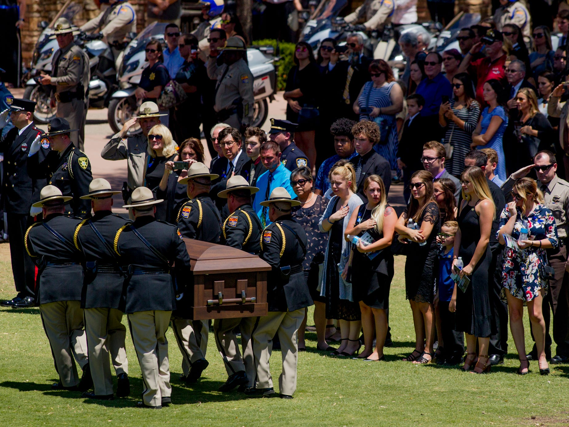 The casket of fallen DPS Trooper Tyler Edenhofer is taken to the hearse on Aug. 3, 2018, during the funeral at Christ's Church of the Valley in Peoria.