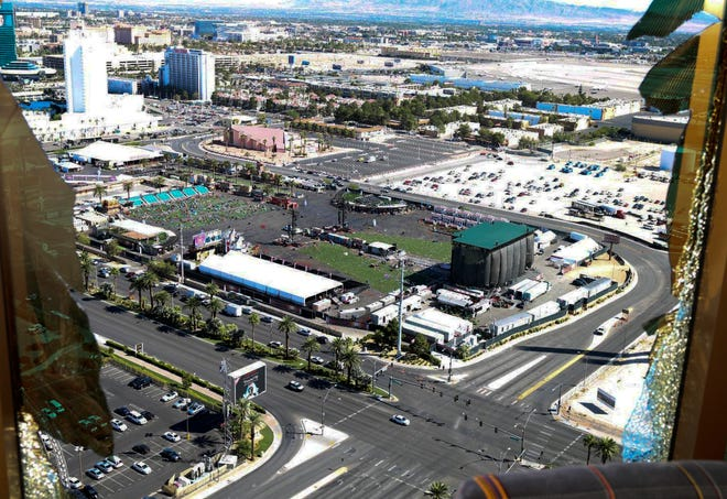 This October 2017 photo released by the Las Vegas Metropolitan Police Department Force Investigation Team Report shows the view of Las Vegas Village from Mandalay Bay's room 32-135, part of the evidence images included on a preliminary report showing the interior of Stephen Paddock's 32nd floor room of the Mandalay Bay hotel in Las Vegas.