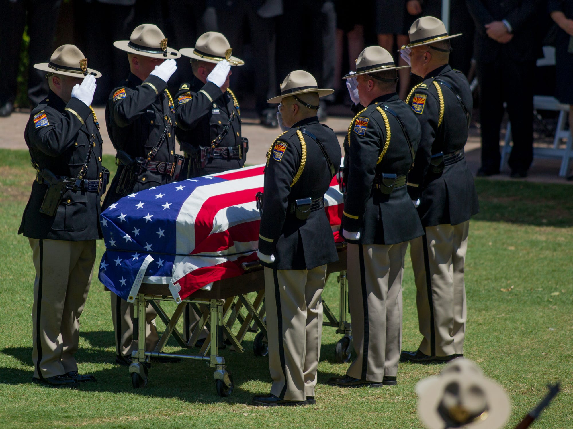 Attendants fold the flag on Aug. 3, 2018, during the funeral for fallen DPS Trooper Tyler Edenhofer at Christ's Church of the Valley in Peoria.