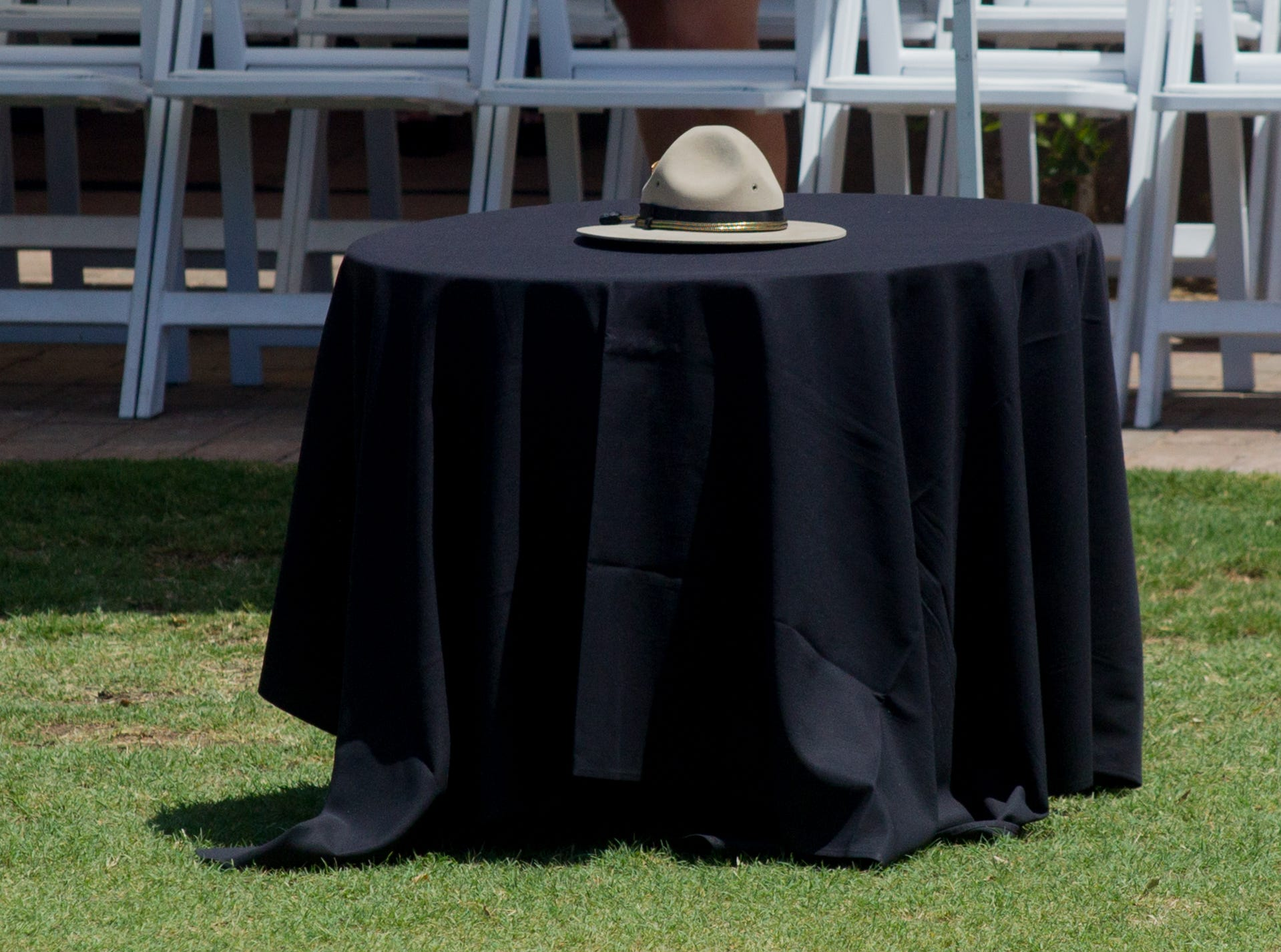 Fallen DPS Trooper Tyler Edenhofer's hat sits on a table on Aug. 3, 2018 during his funeral at Christ's Church of the Valley in Peoria.