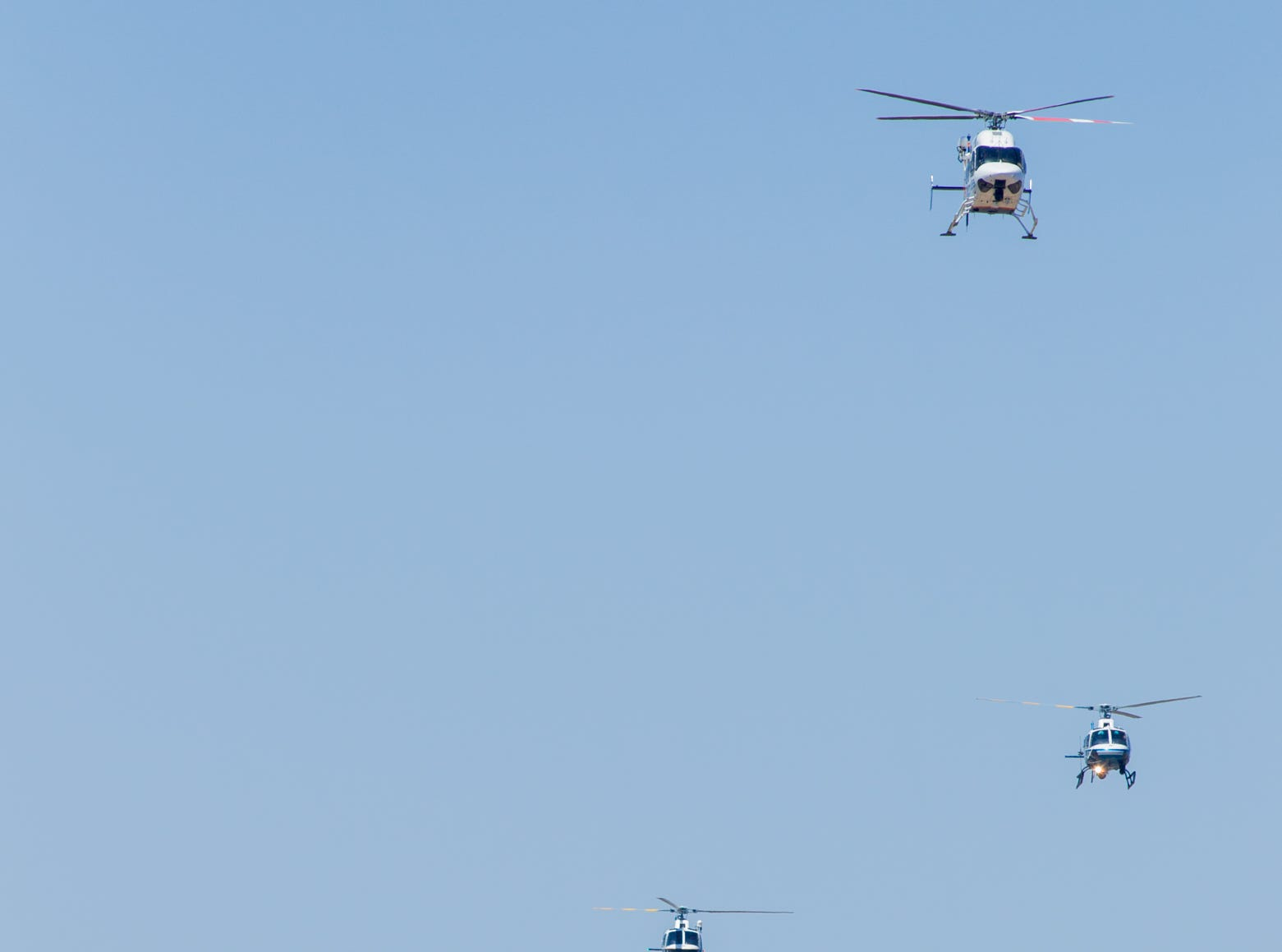 Helicopters fly over the outdoor portion of the memorial service on Aug. 3, 2018, for fallen DPS Trooper Tyler Edenhofer at Christ's Church of the Valley in Peoria.