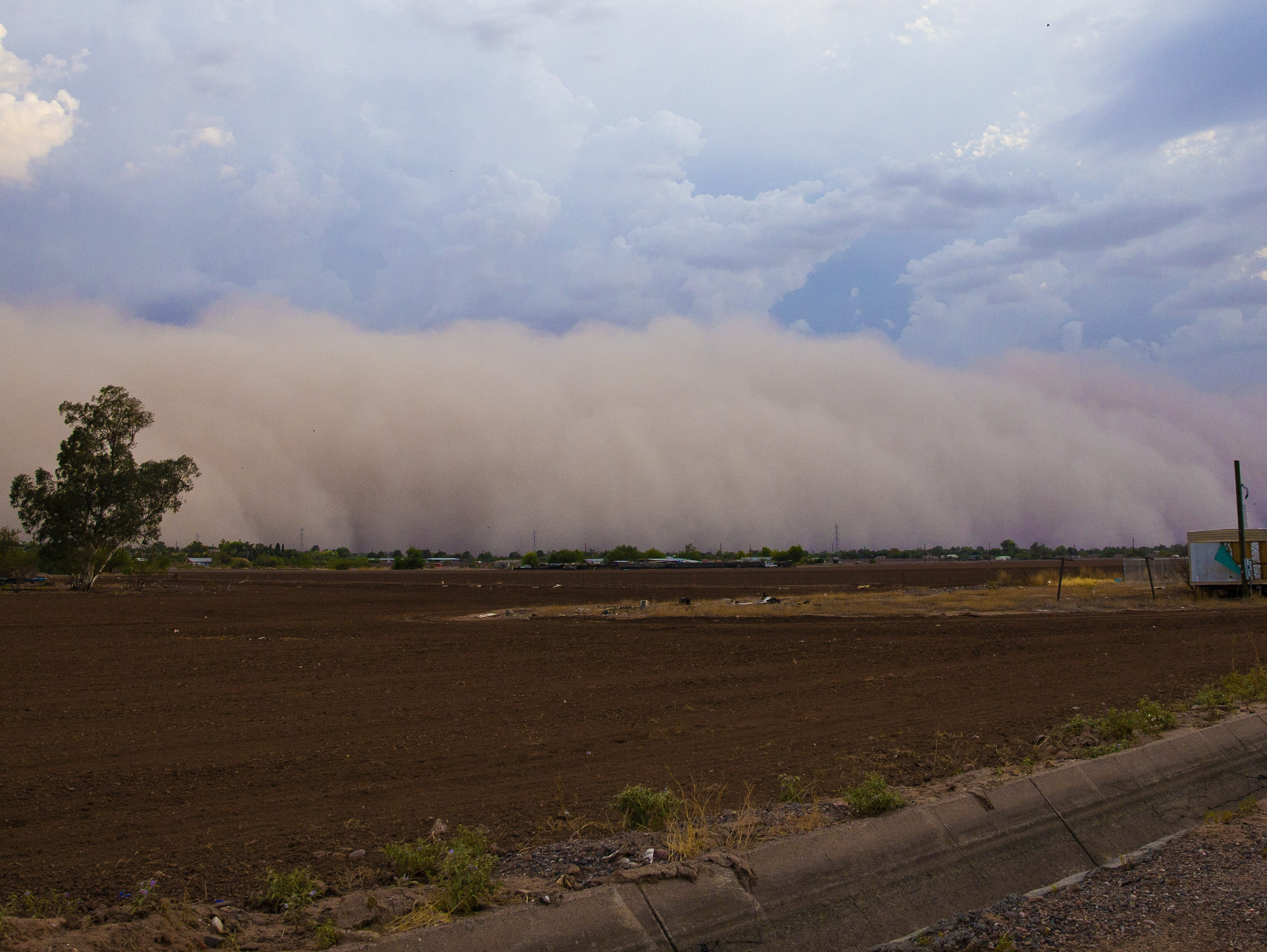 A monsoon dust storm rolls over the Salt River Pima-Maricopa Indian Reservation near Phoenix August 2, 2018.