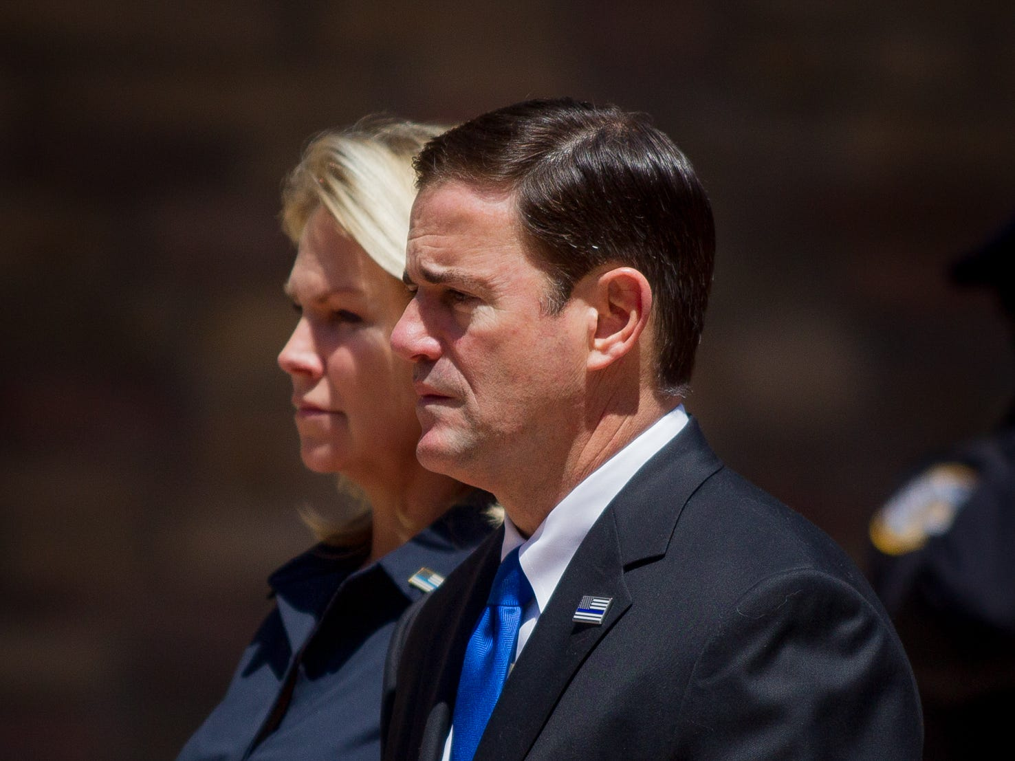 Gov. Doug Ducey walks alongside his wife, Angela Ducey, on Aug. 3, 2018, during the funeral for fallen DPS Trooper Tyler Edenhofer at Christ's Church of the Valley in Peoria.
