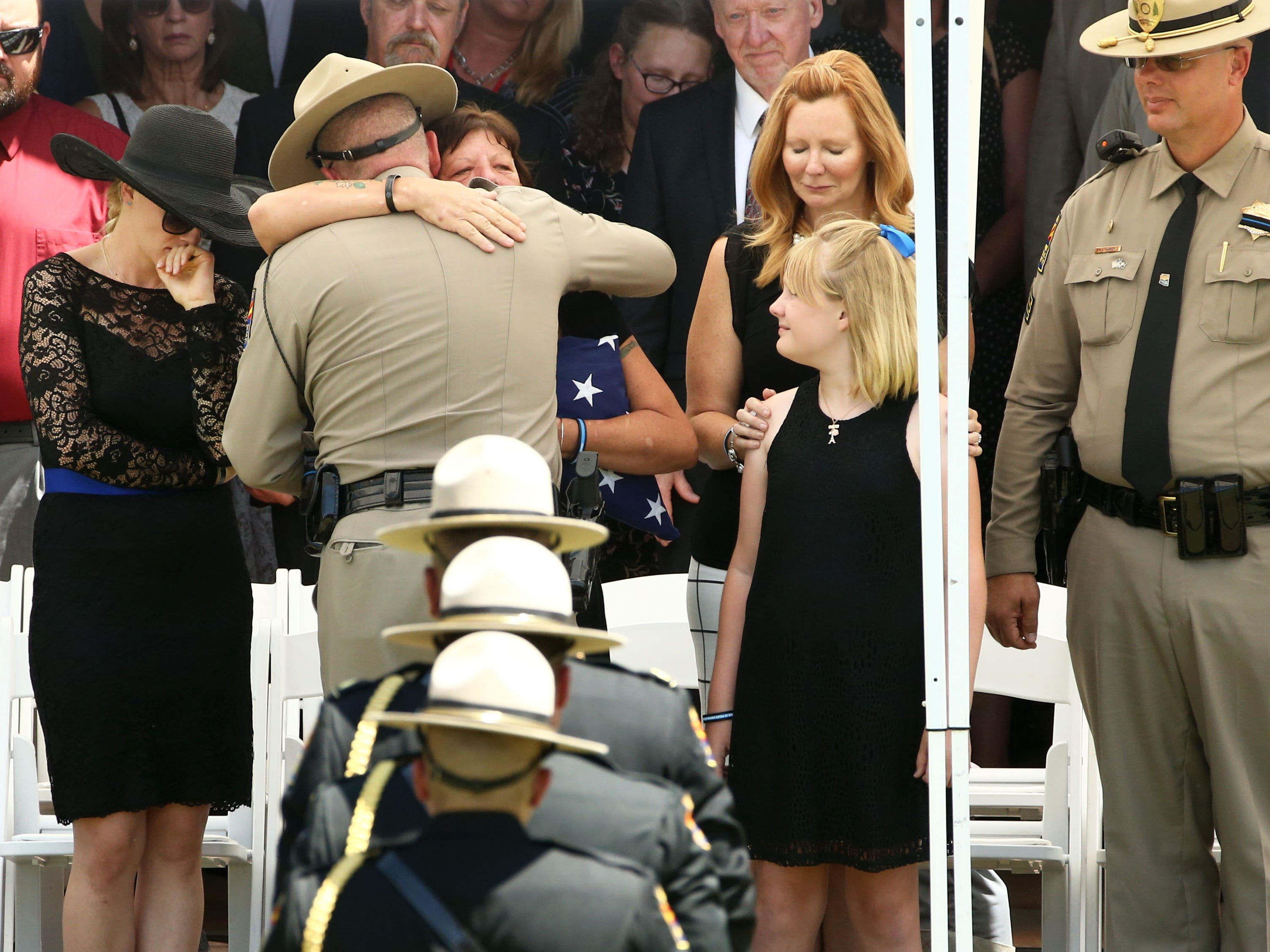 DPS Colonel Frank Milstead hugs the mother of fallen DPS Trooper Tyler Edenhofer during his funeral services Aug. 3, 2018, at Christ's Church of the Valley in Peoria.