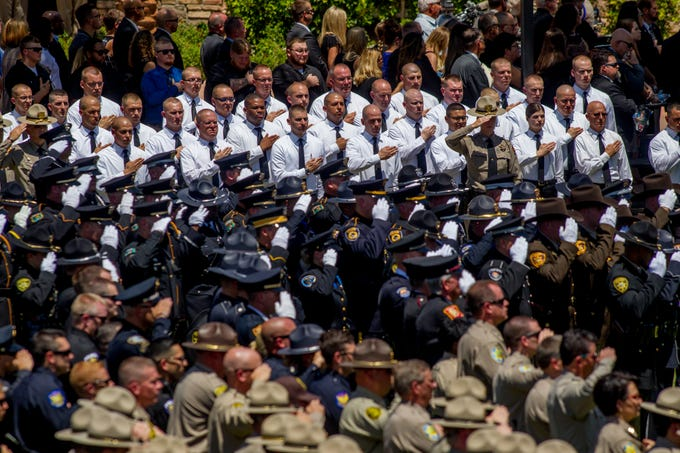 Troopers and emergency personnel pay their respects on Aug. 3, 2018, during a funeral for fallen DPS Trooper Tyler Edenhofer at Christ's Church of the Valley in Peoria.