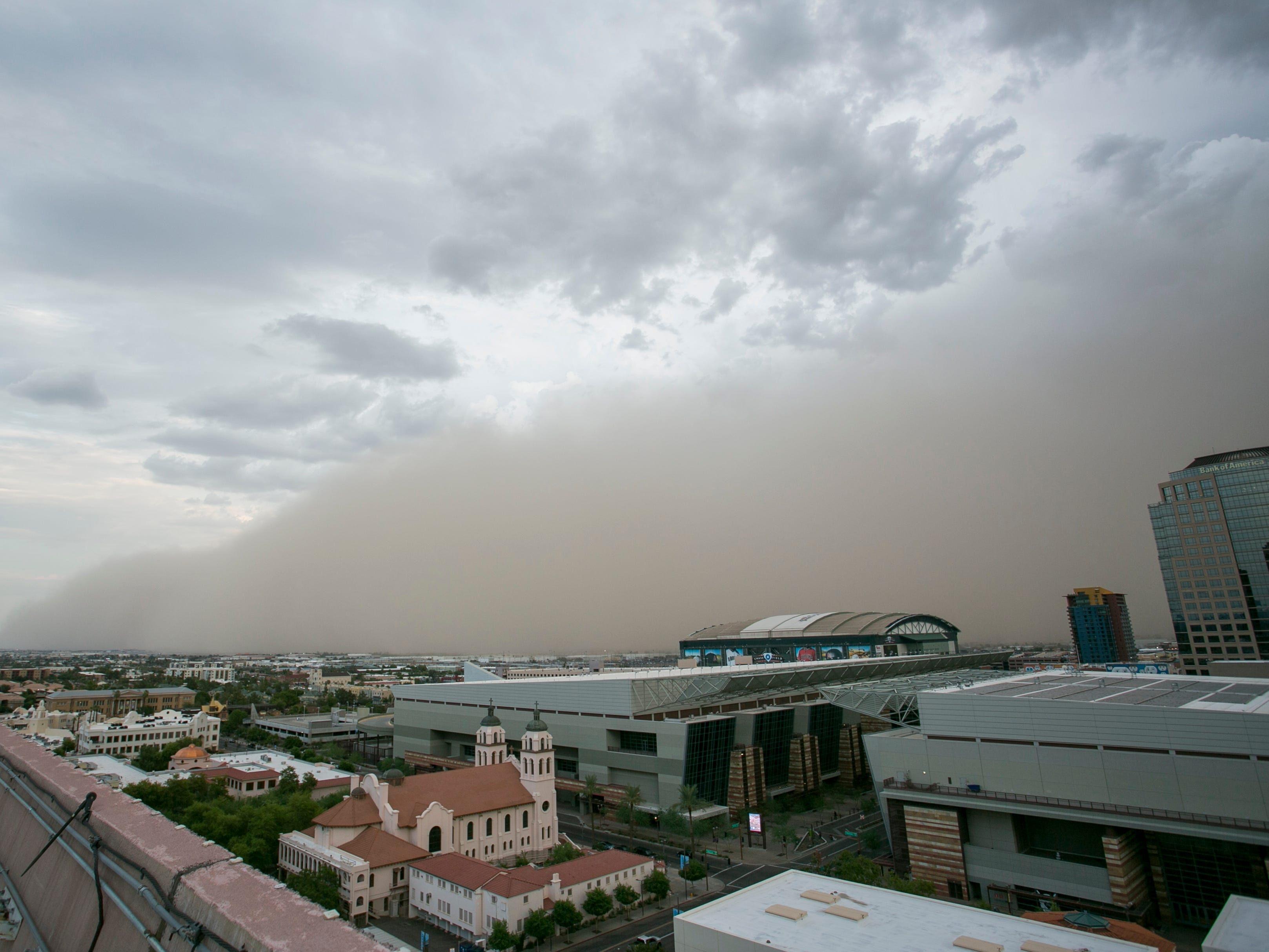 A dust storm approaches downtown Phoenix, Ariz. on Thur. Aug 2, 2018.