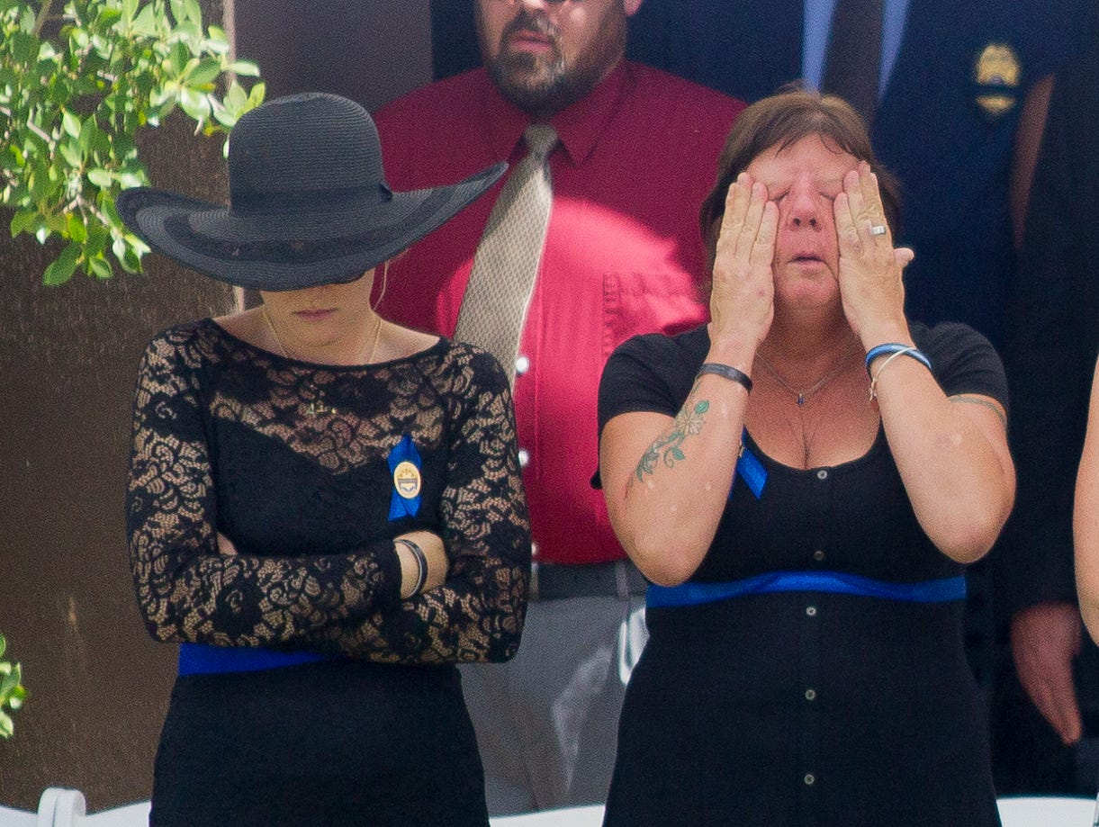 Debbie Edenhofer (right), mother of fallen DPS Trooper Tyler Edenhofer, stands next to Tyler's fiancee, Kaile Sieving, on Aug. 3, 2018, during Tyler's funeral at Christ's Church of the Valley in Peoria.