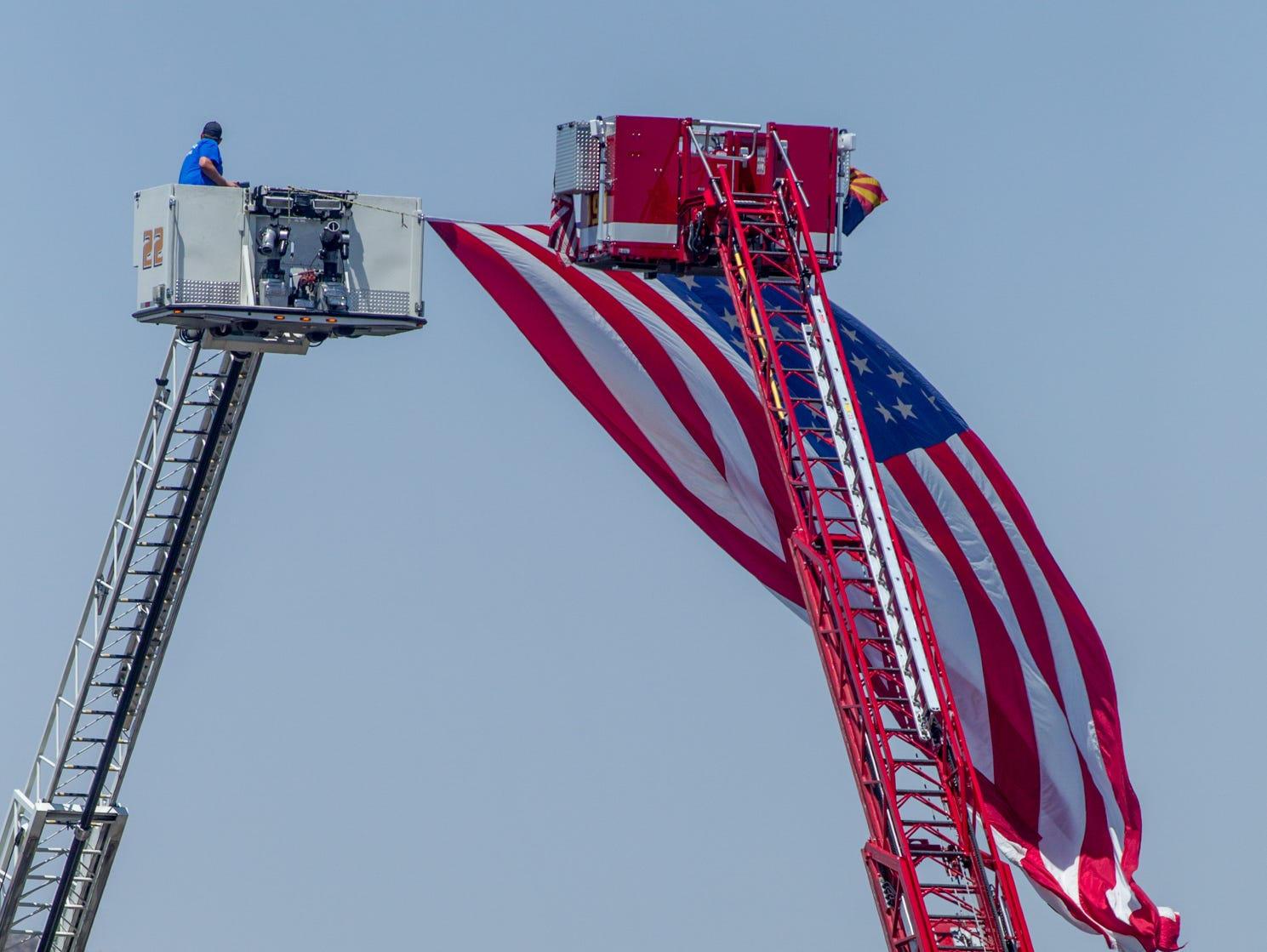 An American flag waves outside Christ's Church of the Valley in Peoria on Aug. 3, 2018, during the funeral for fallen DPS  Trooper Tyler Edenhofer.