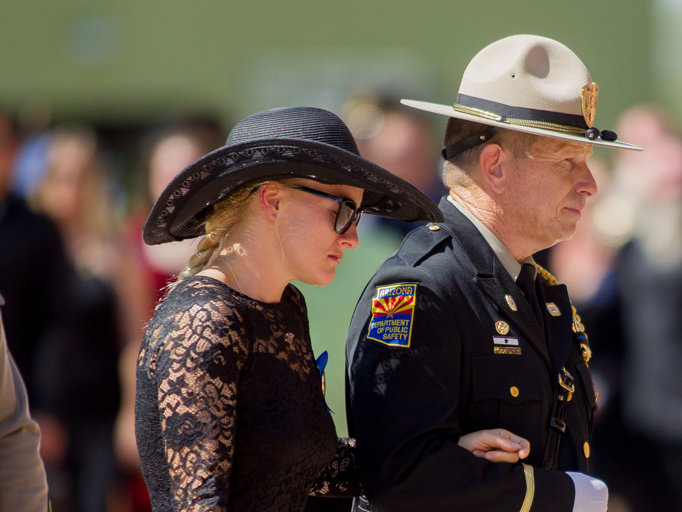 Family and friends are escorted in during the processional of fallen DPS Trooper Tyler Edenhofer's funeral on Aug. 3, 2018, at Christ's Church of the Valley in Peoria.