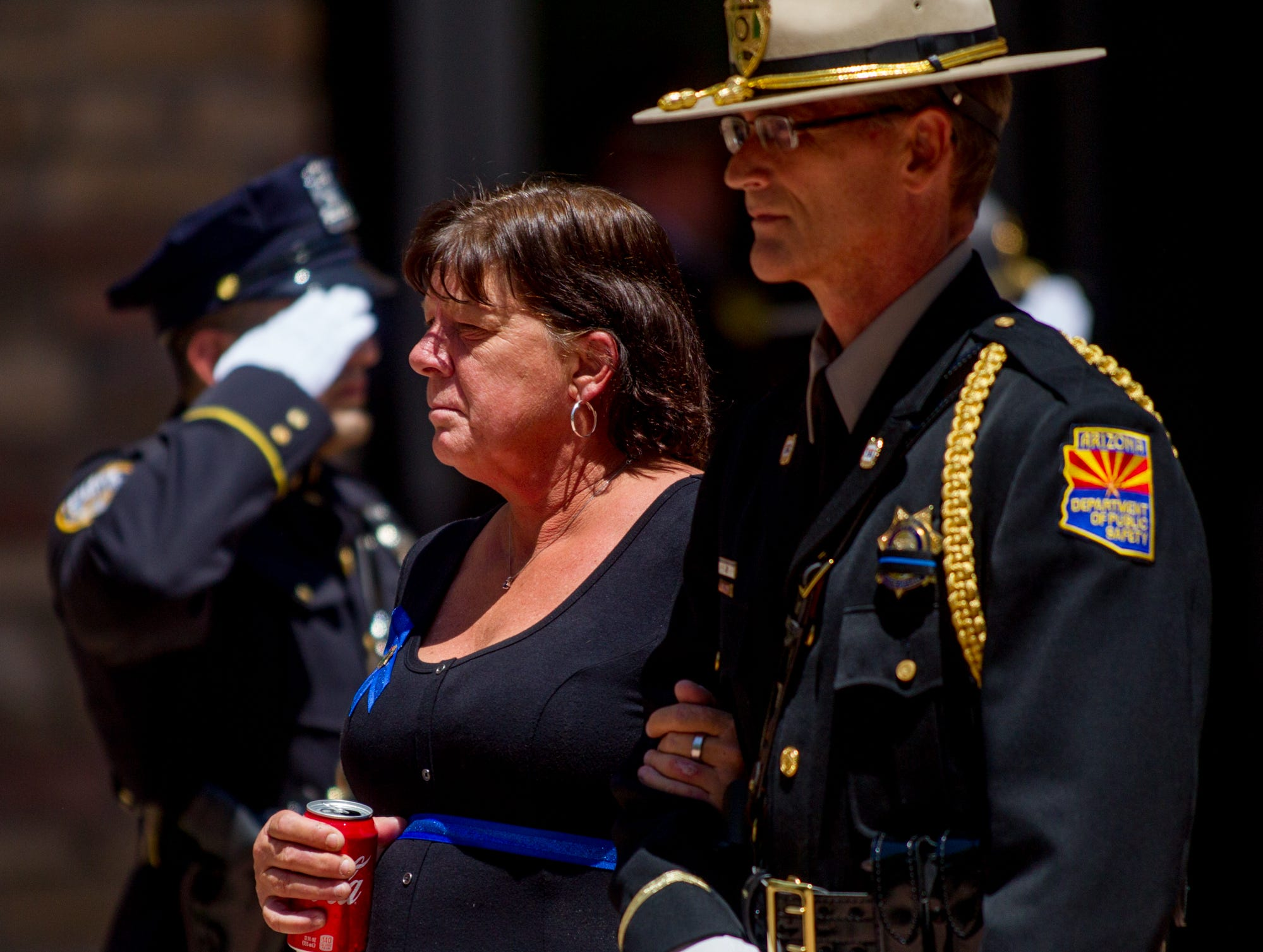 Debbie Edenhofer, mother of fallen DPS Trooper Tyler Edenhofer, walks to the outdoor portion of her son's funeral on Aug. 3, 2018, at Christ's Church of the Valley in Peoria.