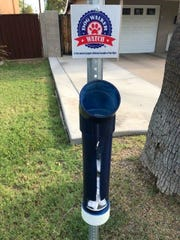 Barbara Orr's neighborhood watch received a grant to create a Dog Walker Watch Program. They put up posts to hold plastic bags for dog poo, and the neighbors keep them filled.
