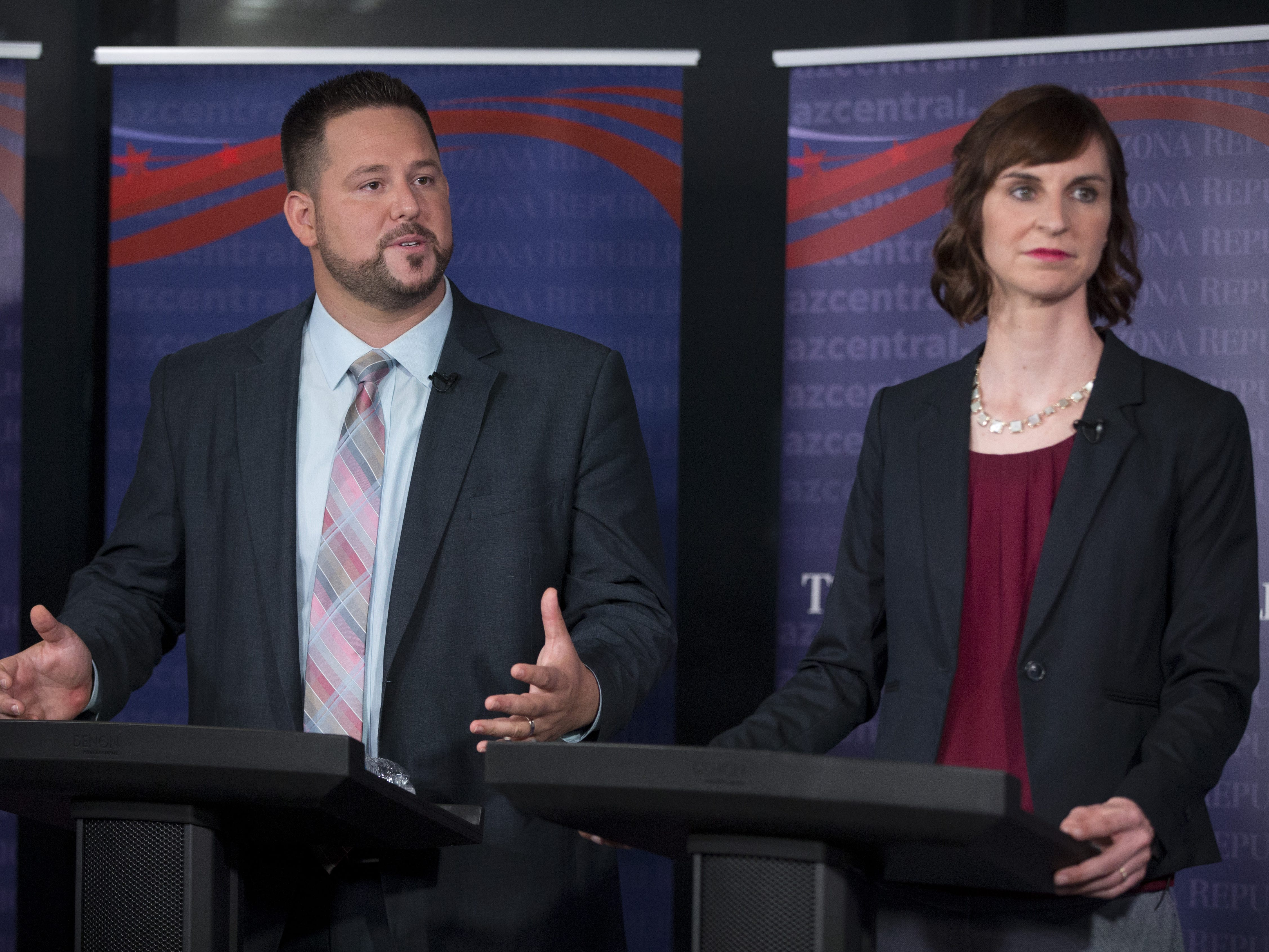 David Schapira, left, and Kathy Hoffman Democratic candidates for state superintendent of public instruction debate at azcentral.com on August 2, 2018.