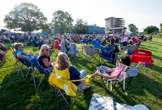 People relaxing in lawn chairs fill Kiefer Park Thursday, Aug. 2, 2018, to listen to local band Double Play at the first Rockin' the Rivers concert of the summer in Port Huron.