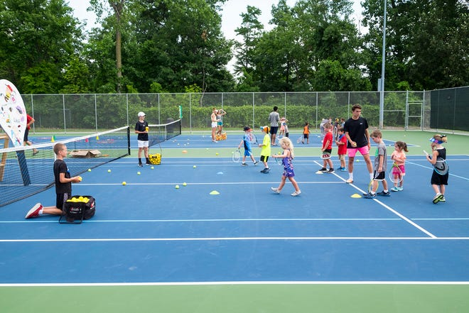 Kids fill the tennis courts at Port Huron Northern High School during the 10&U Play Day Friday, Aug. 3, 2018, at the Francis J. Robinson Memorial International Tennis Tournament.