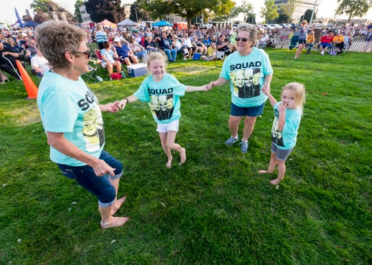"Tina Bernocke, second from right, dances with her granddaughters Addison Berocke, 9, and Gracie Bernocke, 3, and their aunt ""PJ"" Thursday, Aug. 2, 2018, at Rockin' the Rivers at Kiefer Park in Port Huron."