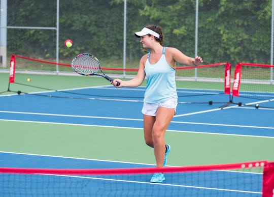 Isabella Murray hits a ball to a kid during the 10&U Play Day Friday, Aug. 3, 2018, at the Francis J. Robinson Memorial International Tennis Tournament at Port Huron Northern High School.