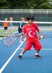 Zishan Lal swings for the ball during the 10&U Play Day Friday, Aug. 3, 2018, at the Francis J. Robinson Memorial International Tennis Tournament at Port Huron Northern High School.