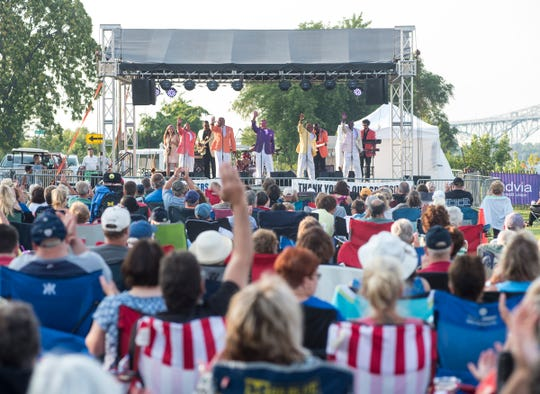 Members of the Detroit Motown group Serieux take the stage Thursday, Aug. 2, 2018, to headline the first of this summer's Rockin' the Rivers concerts at Kiefer Park in Port Huron.