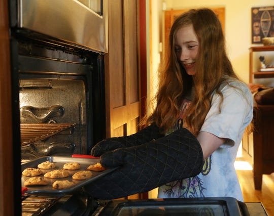 Rachel Fenwick removes a tray of cookies from the oven at her home in Staatsburg on August 1, 2018. Rachel, along with your brother Luke have been baking and entering contests at the Dutchess County Fair as a family.