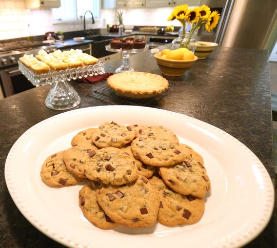 Robb Fessler's baked goods, chocolate chip cookies, key lime bars, Neapolitan cupcakes and a pineapple pie at his home in Rhinebeck on August 3, 2018. Fessler has been avid baker for over a decade and enters his creations in the Dutchess County Fair.