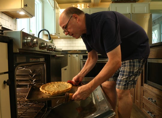 Robb Fessler removes a pineapple pie from the oven at his home in Rhinebeck on August 3, 2018. Fessler, an avid baker for over a decade is experimenting with this pie recipe for this year's Dutchess County Fair.