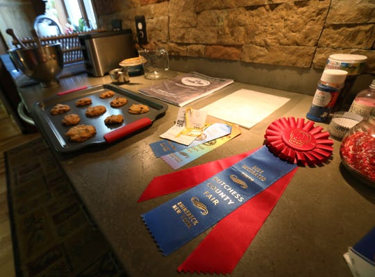 Baking supplies accompanied by ribbons won by the Fenwick family's entries in the Dutchess County Fair at their home in Staatsburg on August 1, 2018.