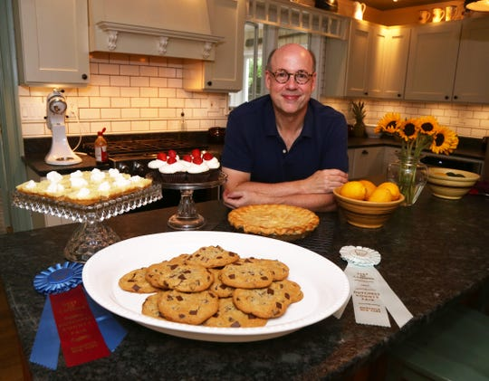Robb Fessler with a collection of his baked goods at his home in Rhinebeck on August 3, 2018. Fessler's passion for baking began about a decade ago, and he has been entering the competitions at the Dutchess County Fair for just as long.