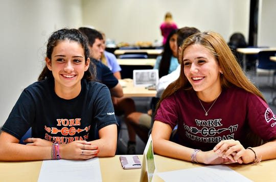 York Suburban girls' cross-country runners Emma Trout, left, and Bryn Walsh are pictured during York-Adams Fall Sports Media Day at the York Newspaper Company in West Manchester Township, Friday, Aug. 3, 2018. Dawn J. Sagert