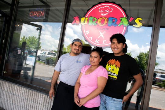 Anselmo Arrieta, left, poses for a photo with his family in front of his new bakery, Aurora's, on Wednesday, August 1, 2018. Aurora's Bakery opened in July 2018, owned and operated by Mexican immigrants Anselmo Arrieta and his wife Guadelupe Rosete. The pair met in New York City, and moved to York in 2002 to 'chase the American Dream.'