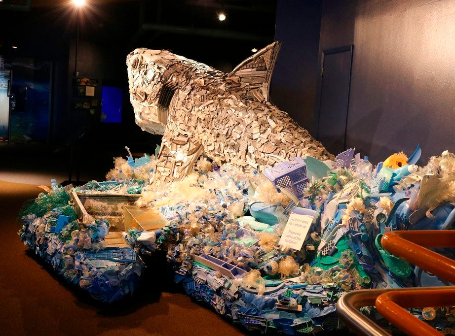 "In this photo taken July 26, 2018, a section of a boat that washed ashore is incorporated into the sculpture of ""Greta the Great White Shark,"" one of six sculptures made out of ocean trash as part of a project called ""Washed Ashore: Art to Save the Sea"" at the Audubon Aquarium of the Americas in New Orleans."