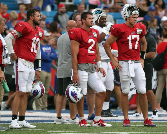 The Bills three quarterbacks  wait to take reps during a training camp practice at New Era Field.