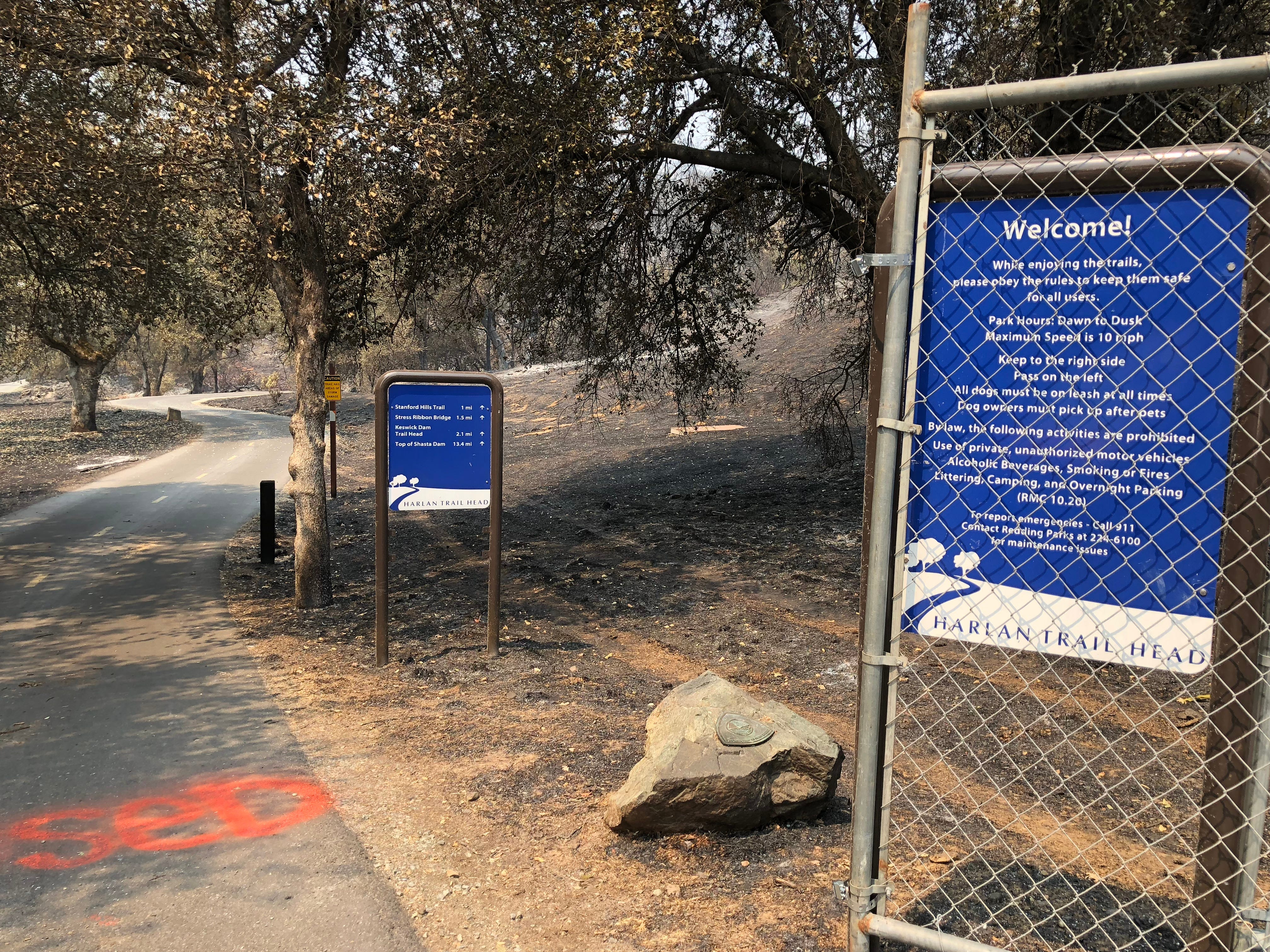The Harlan Trailhead, serving as an access point to the Sacramento River Trail at the end of Harlan Drive in the Lake Redding area, suffered some Carr Fire damage. As residents returned to the newly repopulated area on Friday, this chain-link fence wasn't blocking access to the trail. But officials have advised not to use the trail.