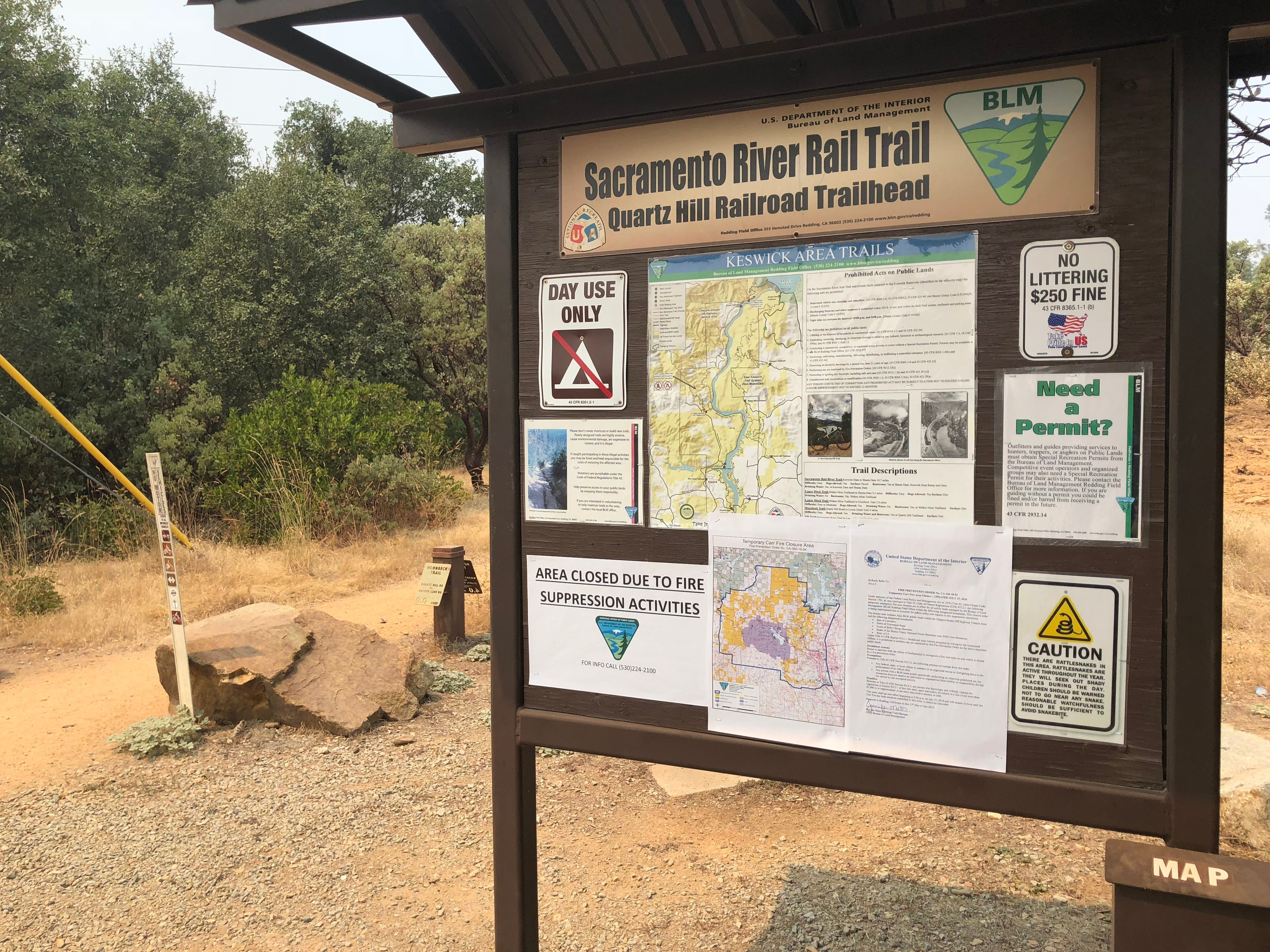 The beginning of the Hornbeck Trail, by the Quartz Hill Railroad Trailhead, appears largely undamaged by the Carr Fire. Although the area is still inaccessible to the public, the air is not very smoky and the water fountain is in working order.