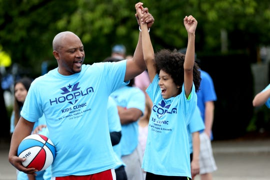 Ethan Cifuentes, 12, of Salem, is honored as the best kid with character by Pee Wee Harrison during the Hoopla Kid's Clinic outside the Oregon State Capitol in Salem on Friday, Aug. 3, 2018.