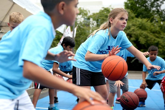 Kids practice dribbling during the Hoopla Kid's Clinic outside the Oregon State Capitol in Salem on Friday, Aug. 3, 2018.