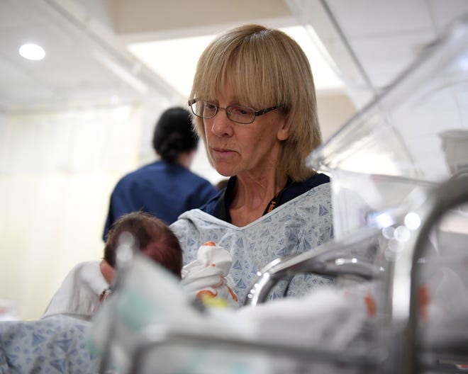 RNC Terri Schoaf feeds a baby in the neonatal intensive care unit at Mercy Medical Center Redding.